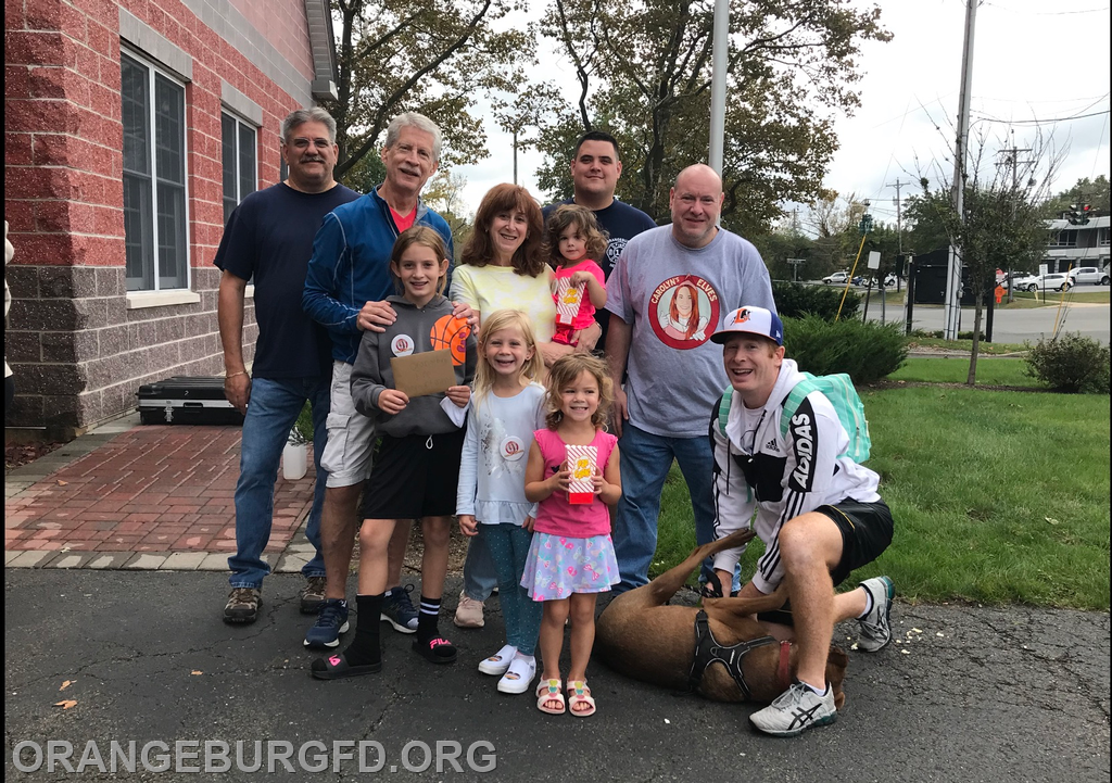 Pictured is Danielle's family w/Commissioner Joe Sassano, Assistant Fire Chief Ken Gordon and Association Vice President JP Yore
